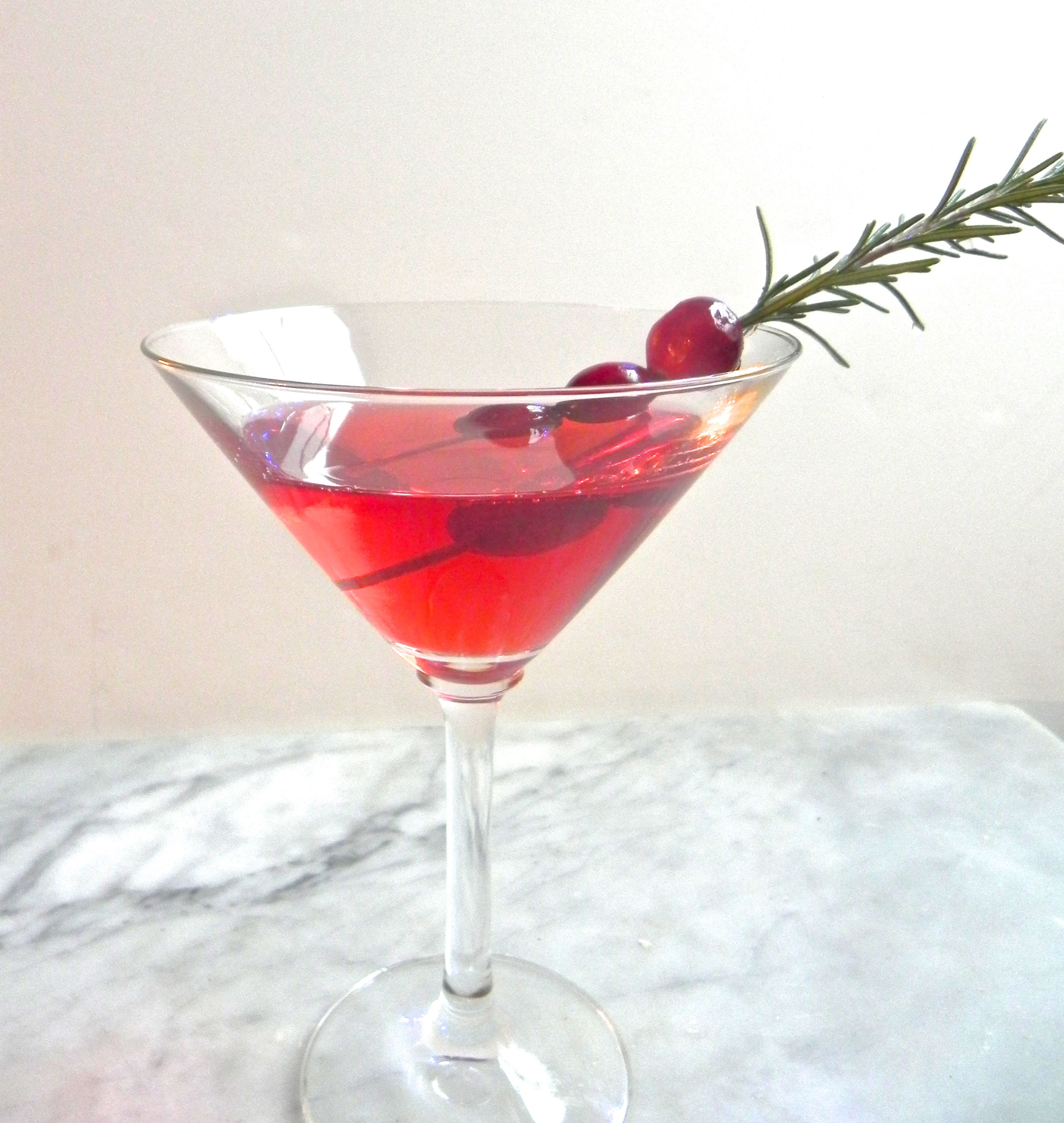 cocktail of spiced cranberry vodka with a splash of ginger ale