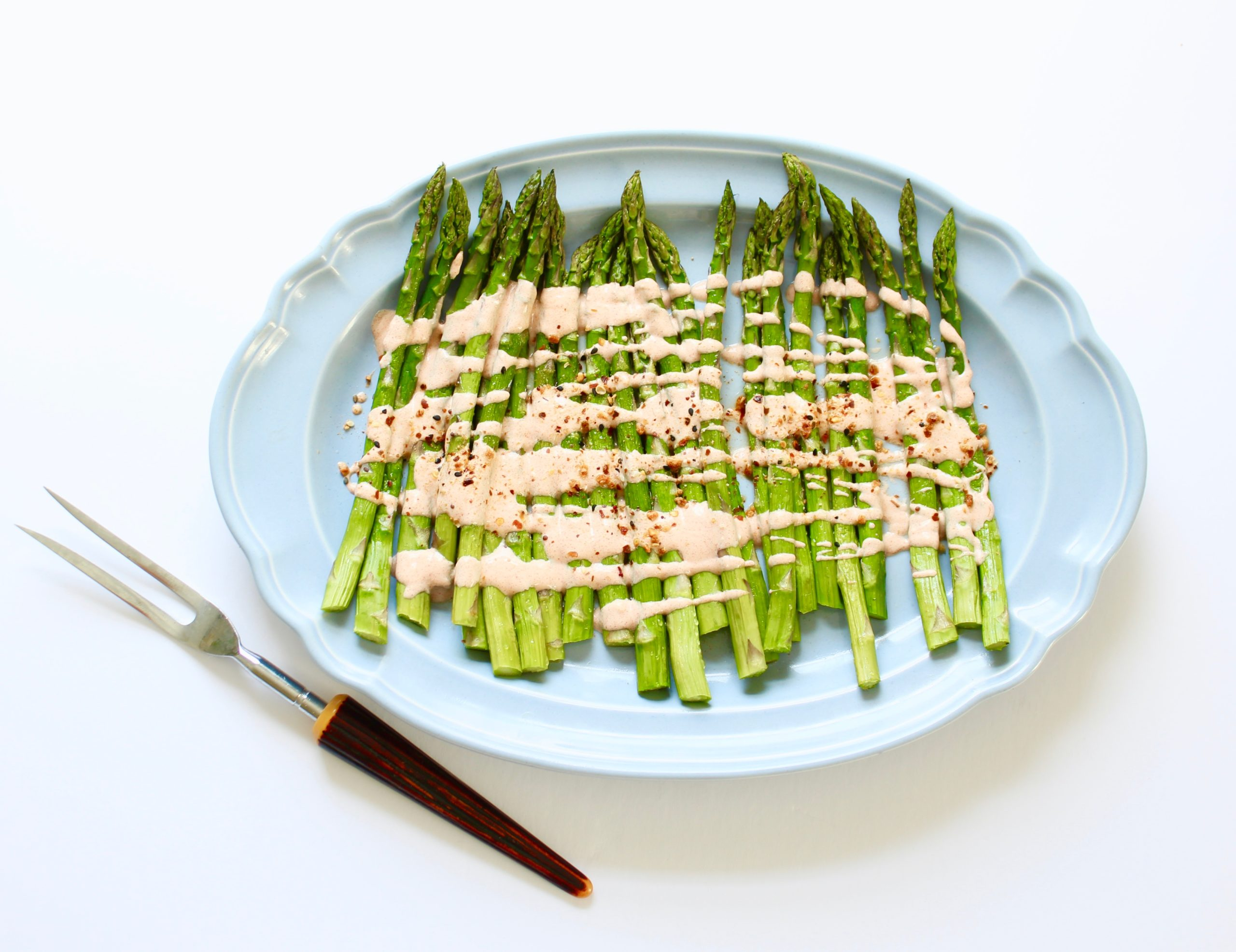 platter of asparagus with smoky yogurt
