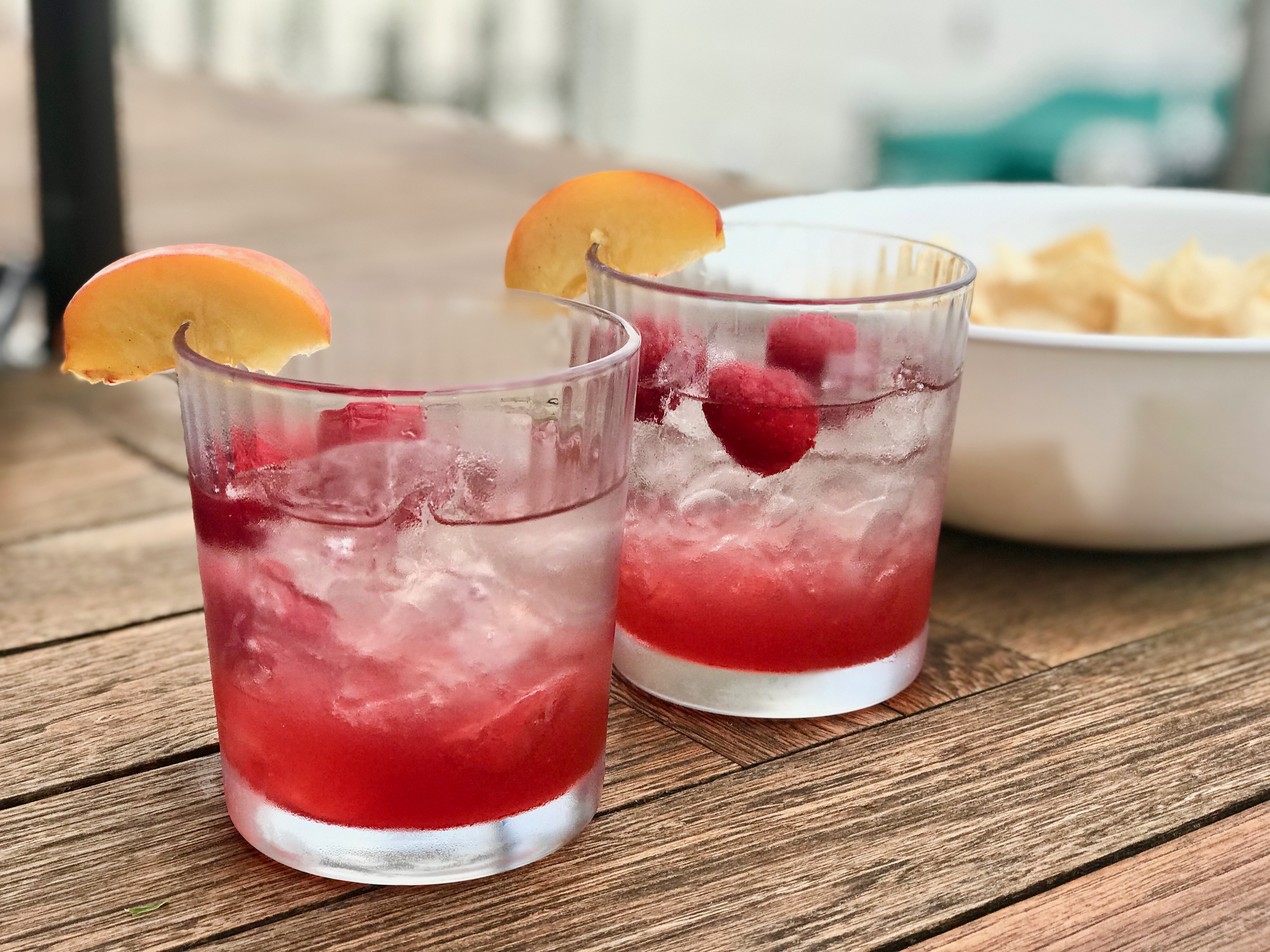 raspberry peach shrub mixed with vodka makes a lively cocktail