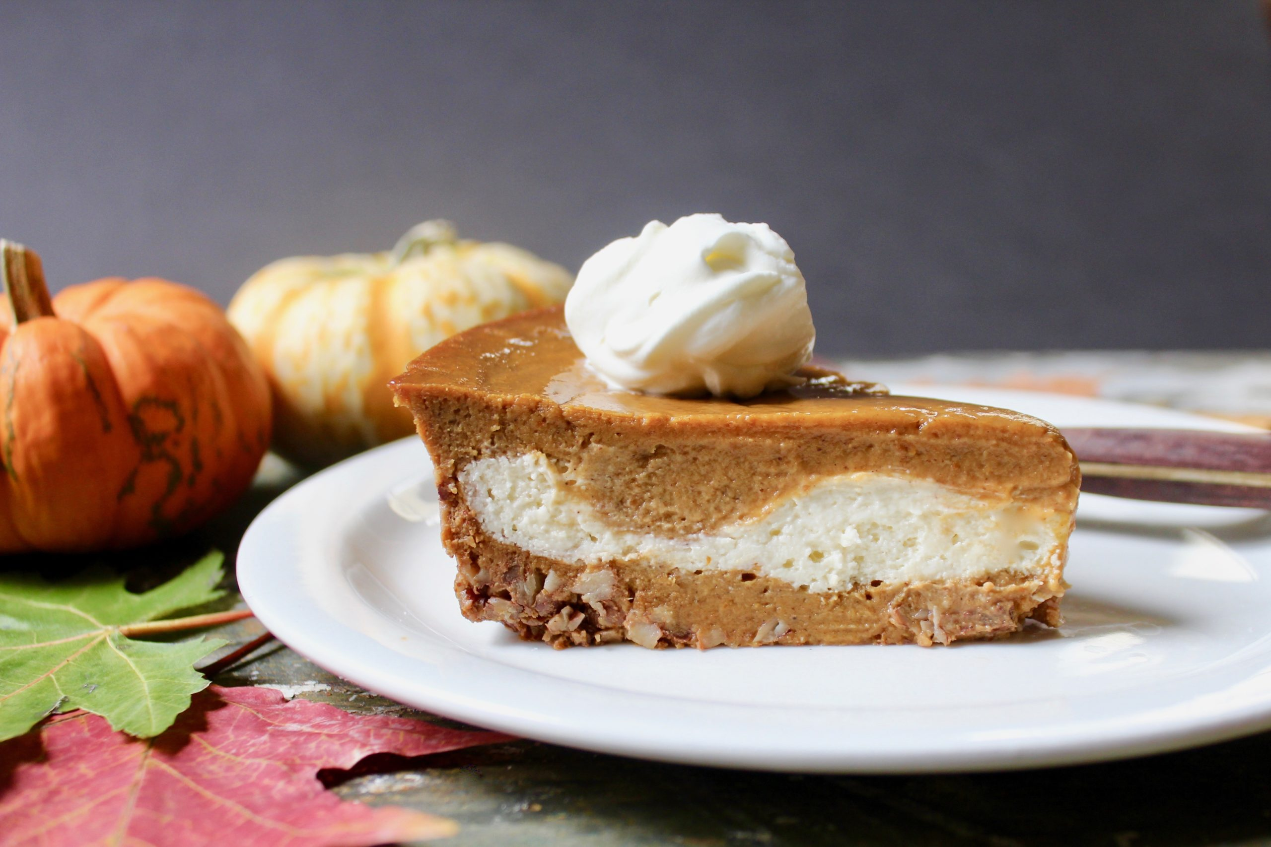slice of pumpkin cheesecake pie