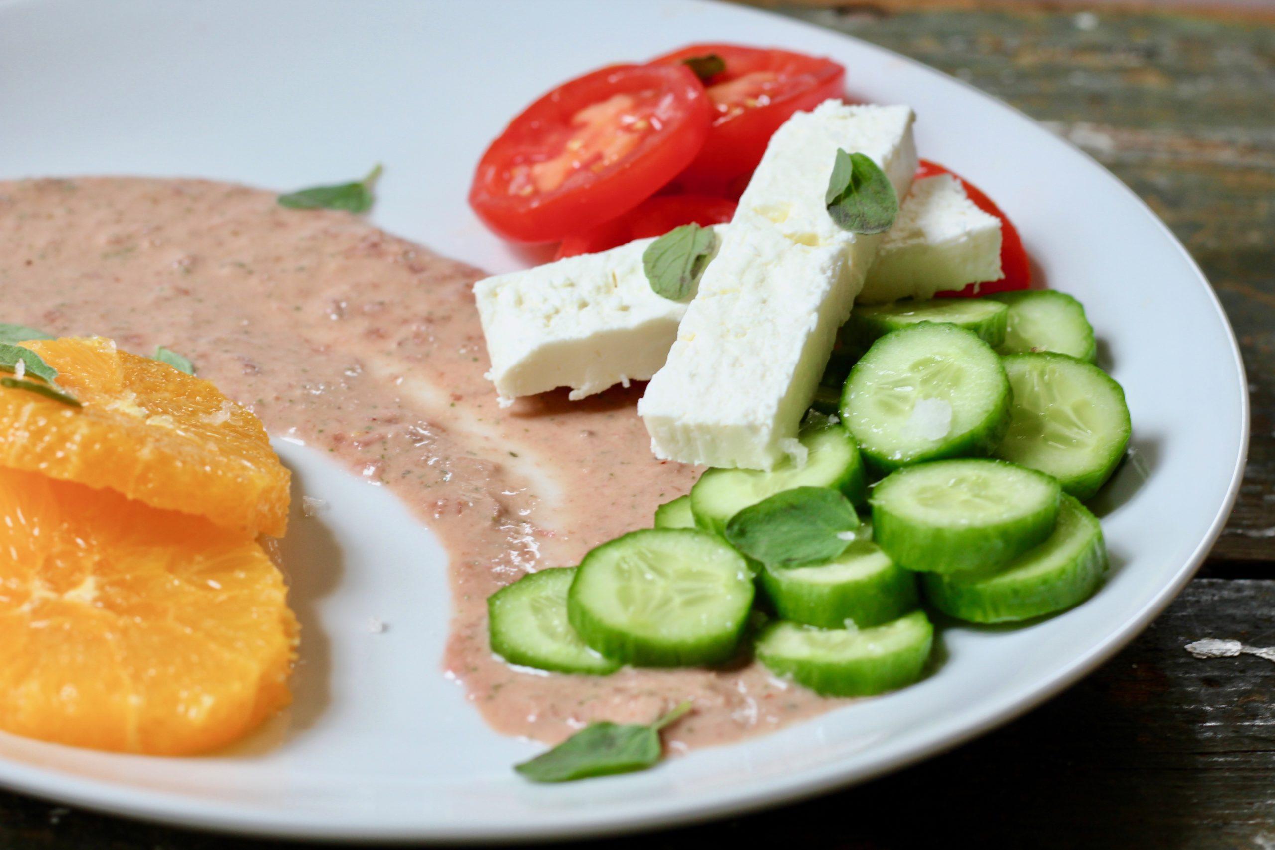 closeup of greek salad with orange