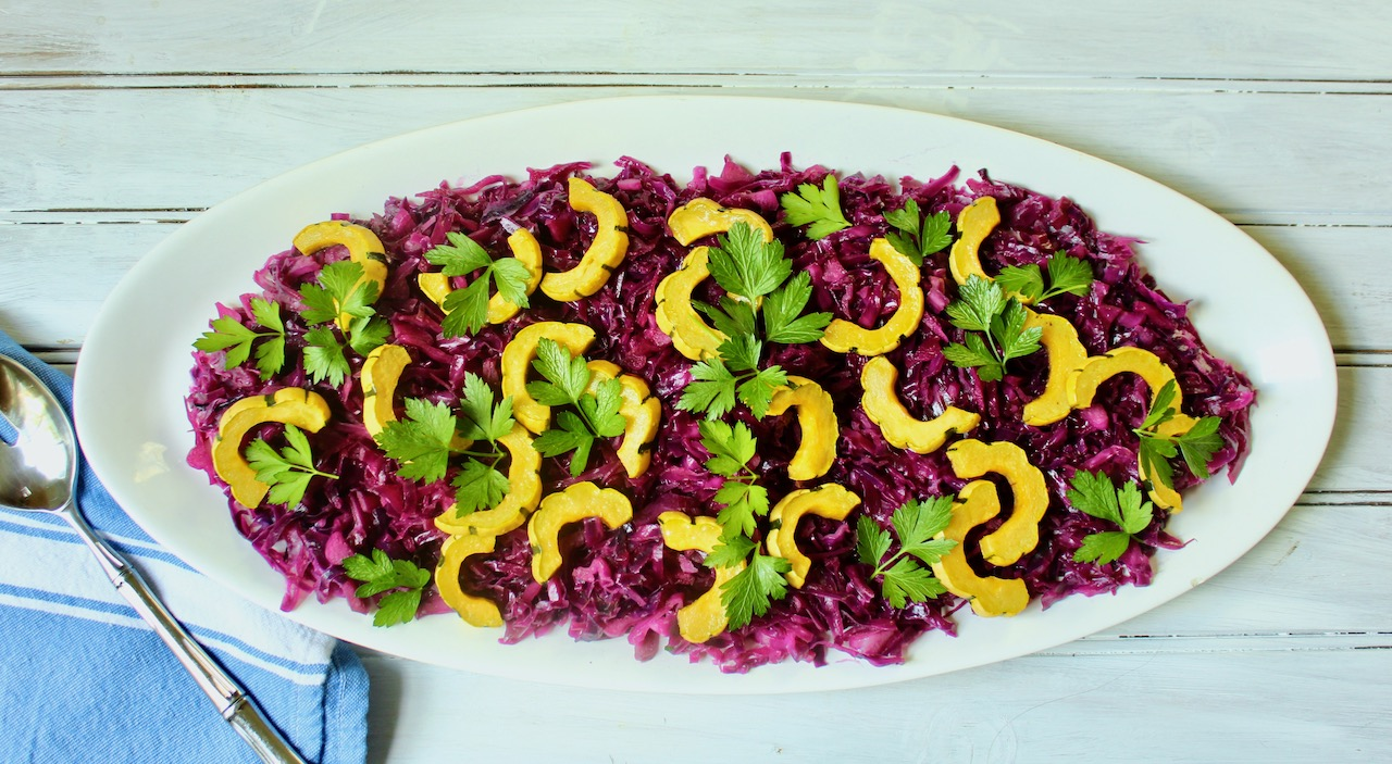 platter of red cabbage and delicata squash