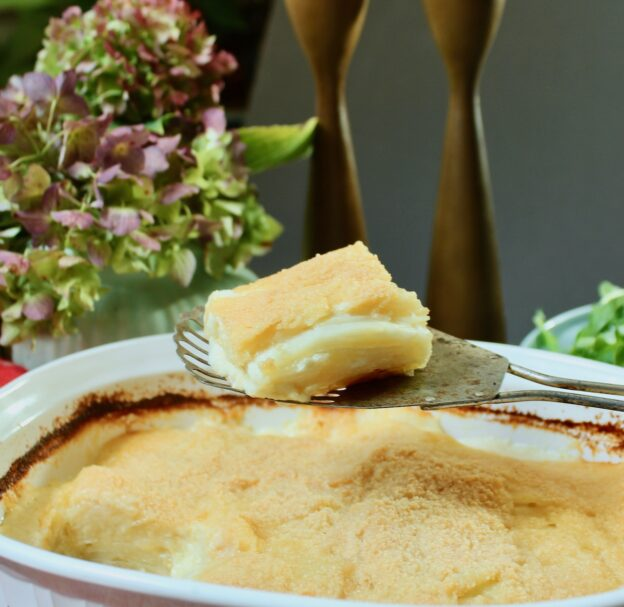 slice of cheddar parmesan potato gratin