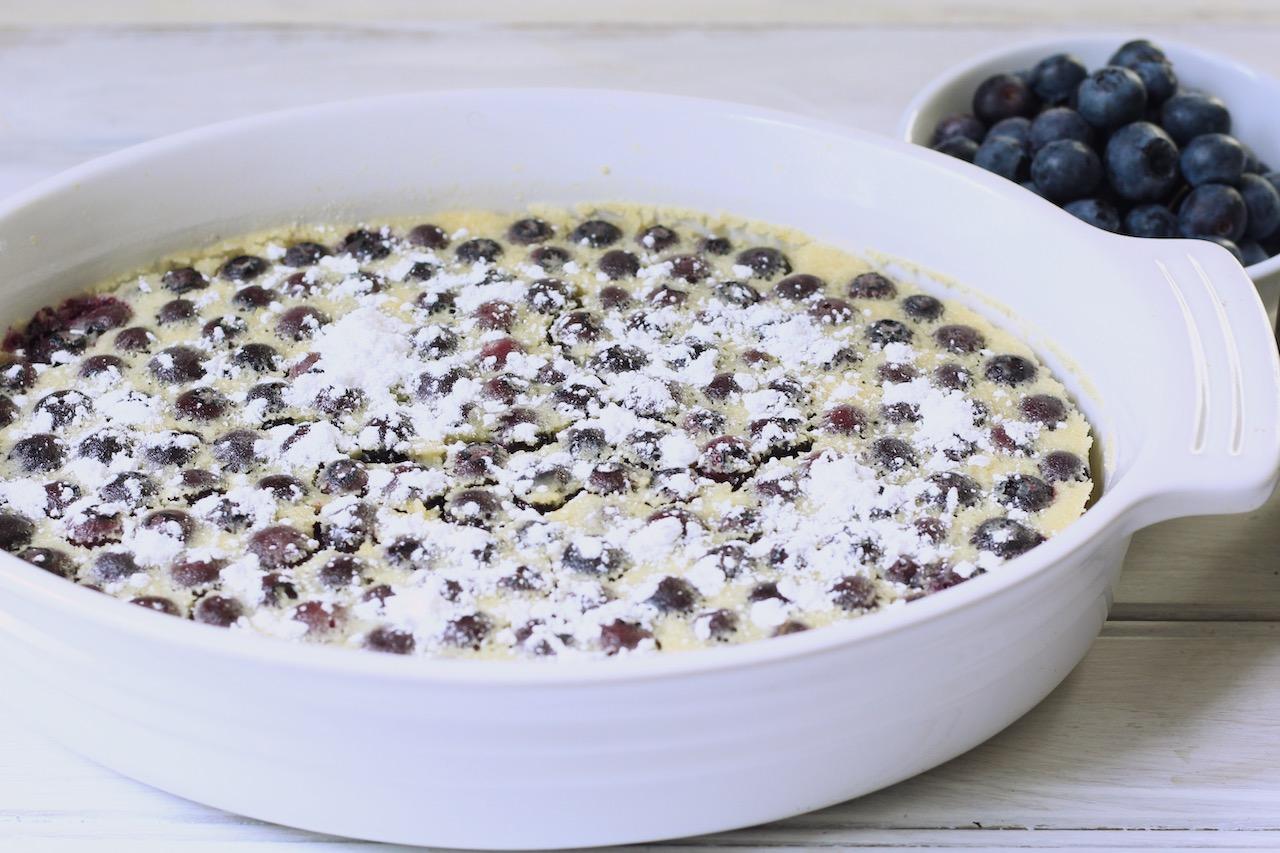 blueberry lemon pudding cake with powdered sugar