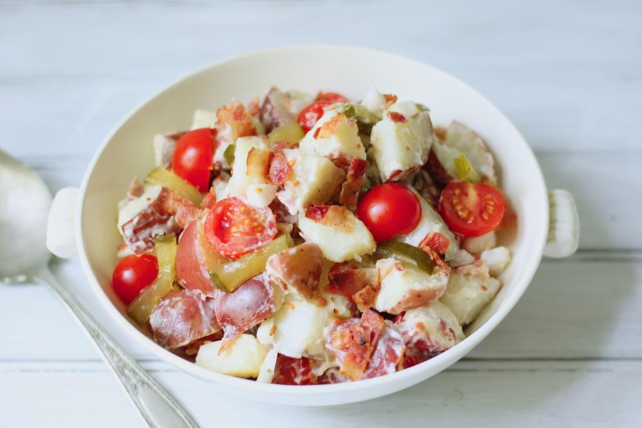 closeup of bacon tomato potato salad